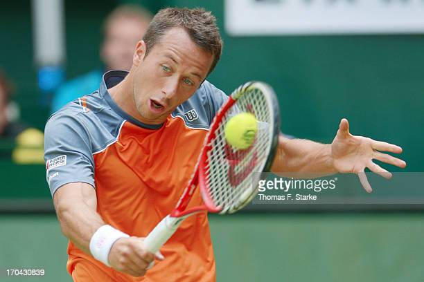 Philipp Kohlschreiber of Germany plays a backhand in his match against Tobias Kamke of Germany during day four of the Gerry Weber Open at Gerry Weber...