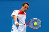 Philipp Kohlschreiber of Germany plays a backhand in his second round match against Pere Riba of Spain during day three of the 2012 Australian Open...