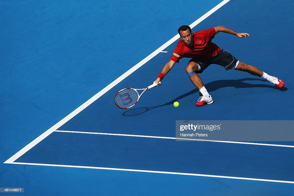 <a gi-track='captionPersonalityLinkClicked' href=/galleries/search?phrase=Philipp+Kohlschreiber&family=editorial&specificpeople=225202 ng-click='$event.stopPropagation()'>Philipp Kohlschreiber</a> of Germany plays a forehand against John Isner of the USA during day four of the Heineken Open at ASB Tennis Centre on January 9, 2014 in Auckland, New Zealand.