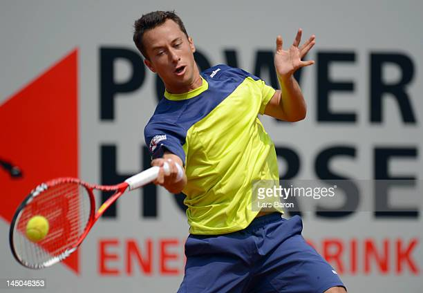 Philipp Kohlschreiber of Germany plays a forehand during his match against Lovro Zovko of Croatia during day four of Power Horse World Team Cup at...