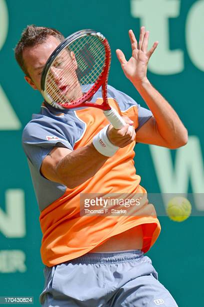 Philipp Kohlschreiber of Germany plays a forehand in his match against Tobias Kamke of Germany during day four of the Gerry Weber Open at Gerry Weber...