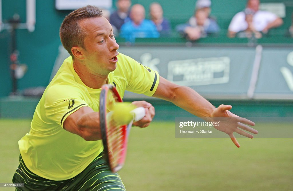 Philipp Kohlschreiber of Germany plays a forehand in his match against Roger Federer of Switzerland during day one of the Gerry Weber Open at Gerry...