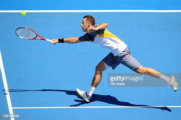 Philipp Kohlschreiber of Germany plays a forehand in his second round match against Alejandro Falla of Colombia during day three of the Heineken Open...