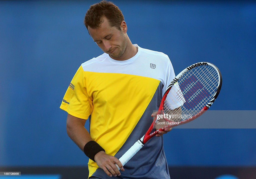 Philipp Kohlschreiber of Germany reacts in his third round match against Milos Raonic of Canada during day six of the 2013 Australian Open at Melbourne Park on January 19, 2013 in Melbourne, Australia.