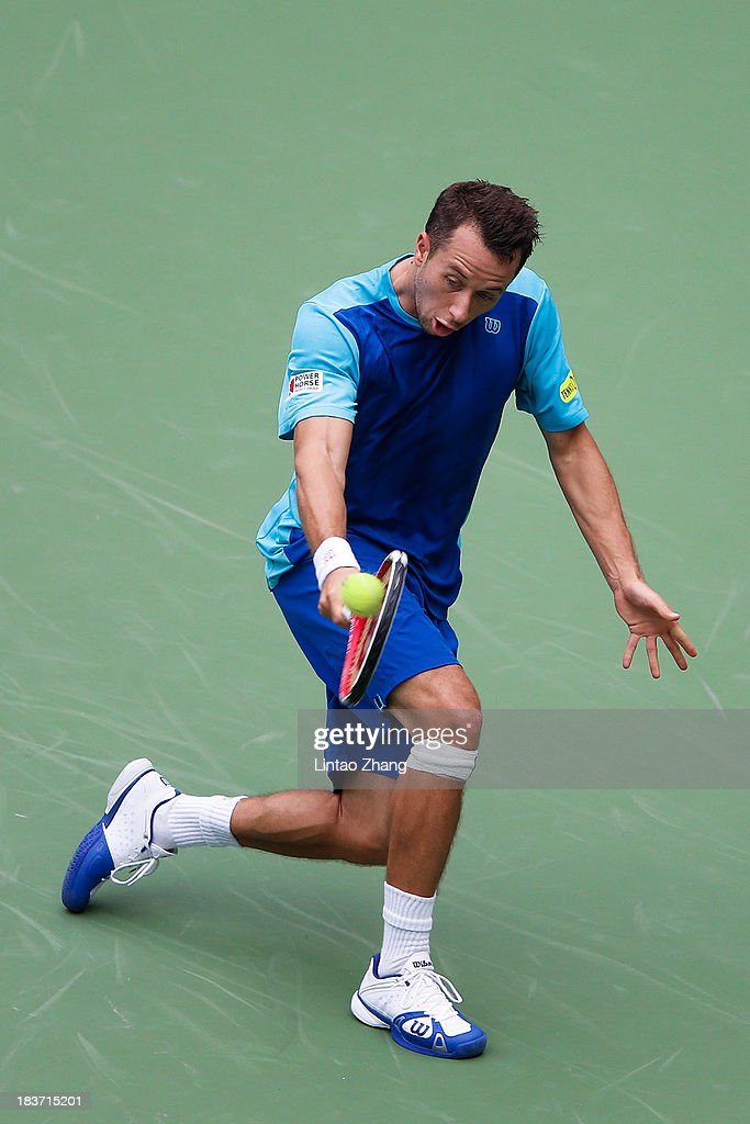 Philipp Kohlschreiber of Germany returns a shot to Juan Martin Del Potro of Argentina during day three of the Shanghai Rolex Masters at the Qi Zhong Tennis Center on October 9, 2013 in Shanghai, China.