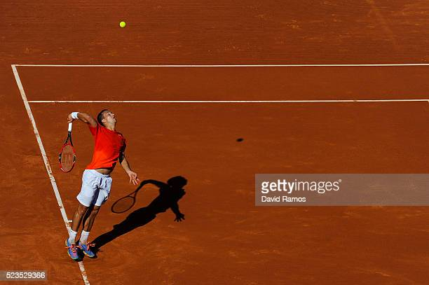 Philipp Kohlschreiber of Germany serves against Rafael Nadal of Spain during day six of the Barcelona Open Banc Sabadell at the Real Club de Tenis...