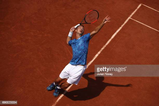 Philipp Kohlschreiber of Germany serves during the mens singles first round match against Nick Kygrios of Australia on day three of the 2017 French...
