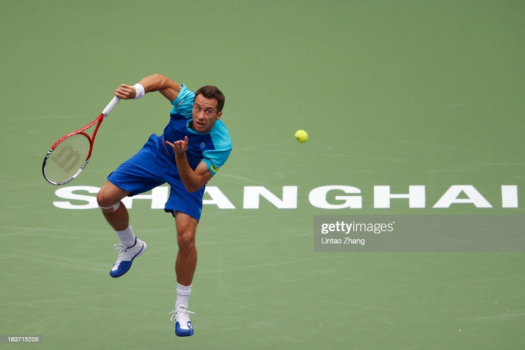Philipp Kohlschreiber of Germany serves to Juan Martin Del Potro of Argentina during day three of the Shanghai Rolex Masters at the Qi Zhong Tennis Center on October 9, 2013 in Shanghai, China.