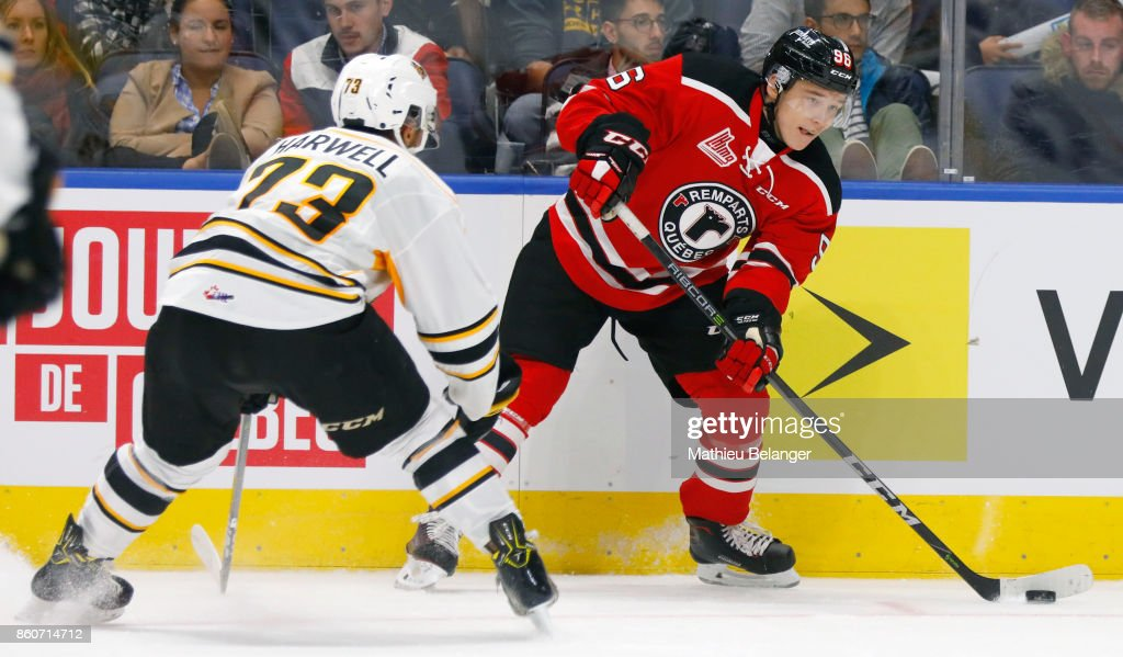 Philipp Kurashev #96 of the Quebec Remparts passes the puck against the Victoriaville Tigres during the third period of their QMJHL hockey game at the Centre Videotron on October 12, 2017 in Quebec City, Quebec, Canada.