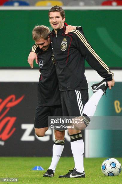 Philipp Lahm and Arne Friedrich of Germany stretch during a German National team training session at the Esprit Arena on November 17 2009 in...