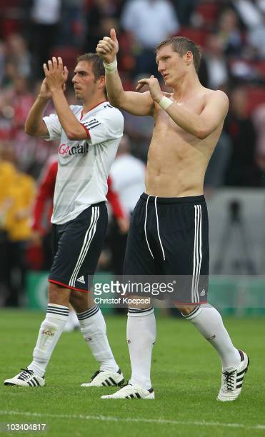 Philipp Lahm and Bastian Schweinsteiger of Bayern celebrate the 40 victory after the DFB Cup first round match between TSV G Windeck and FC Bayern...