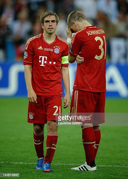 Philipp Lahm and Bastian Schweinsteiger of Bayern Muenchen look dejected after their defeat in the UEFA Champions League Final between FC Bayern...