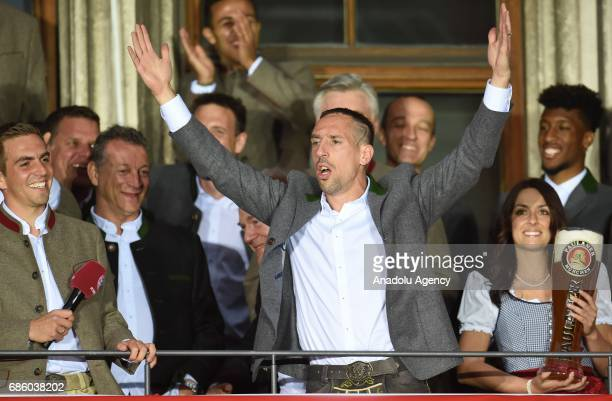 Philipp Lahm and Franck Ribery of Bayern Munich celebrate winning the German soccer championship on a balcony of the town hall in Munich Germany on...