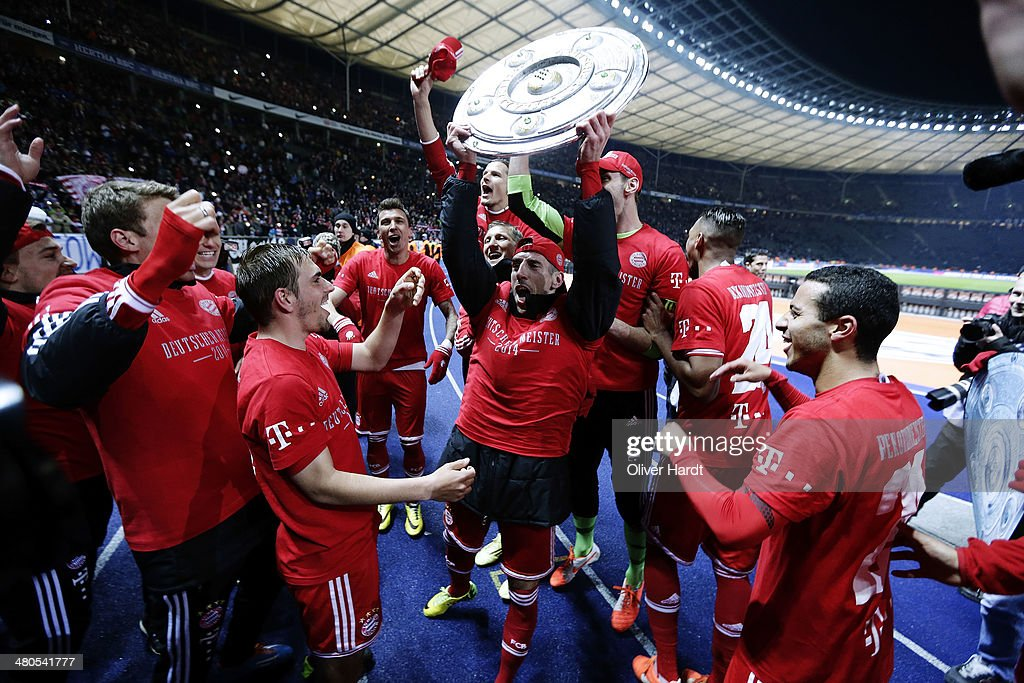 Philipp Lahm (L) and Frank Ribery (R) of Munich celebrates after the Bundesliga match between and Hertha BSC and FC Bayern Muenchen at Olympiastadion on March 25, 2014 in Berlin, Germany.