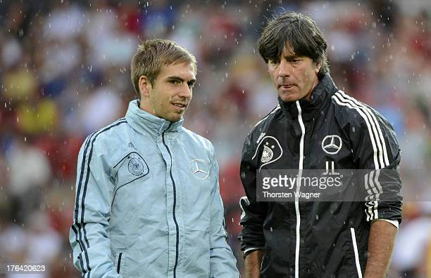 Philipp Lahm and head coach Joachim Loew talks during the German National Football Team trainings session at Coface Arena on August 12 2013 in Mainz...