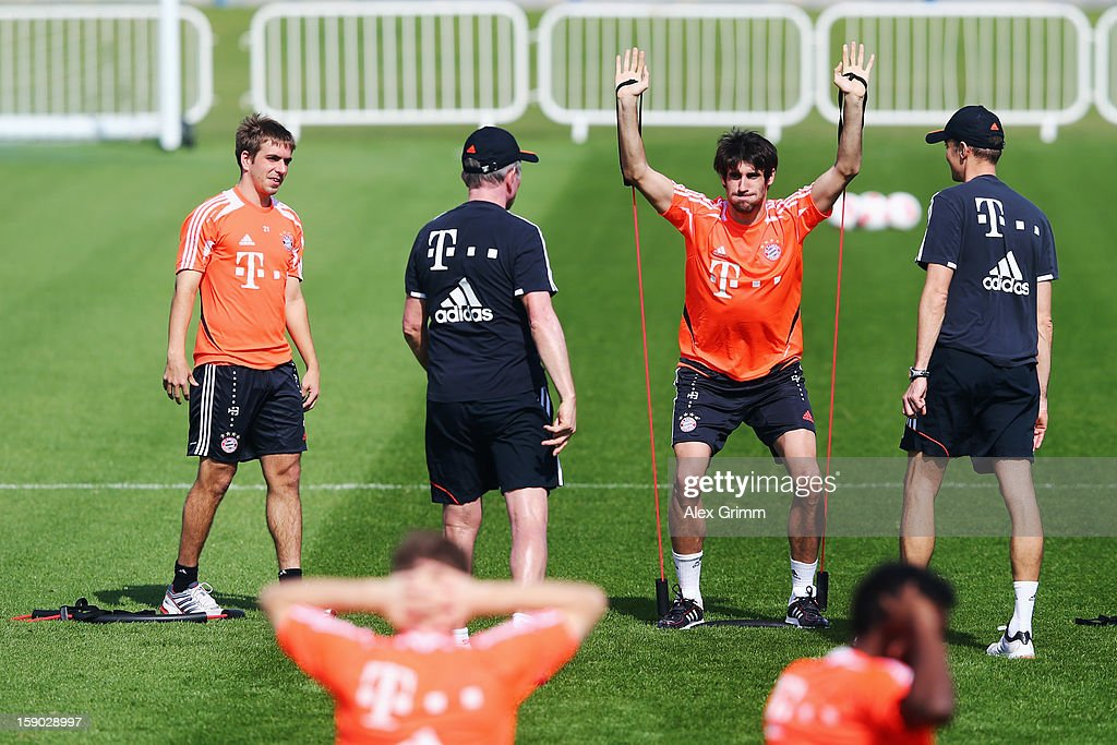 Philipp Lahm and head coach Jupp Heynckes watch Javier Martinez exercise during a Bayern Muenchen training session at the ASPIRE Academy for Sports Excellence on January 6, 2013 in Doha, Qatar.