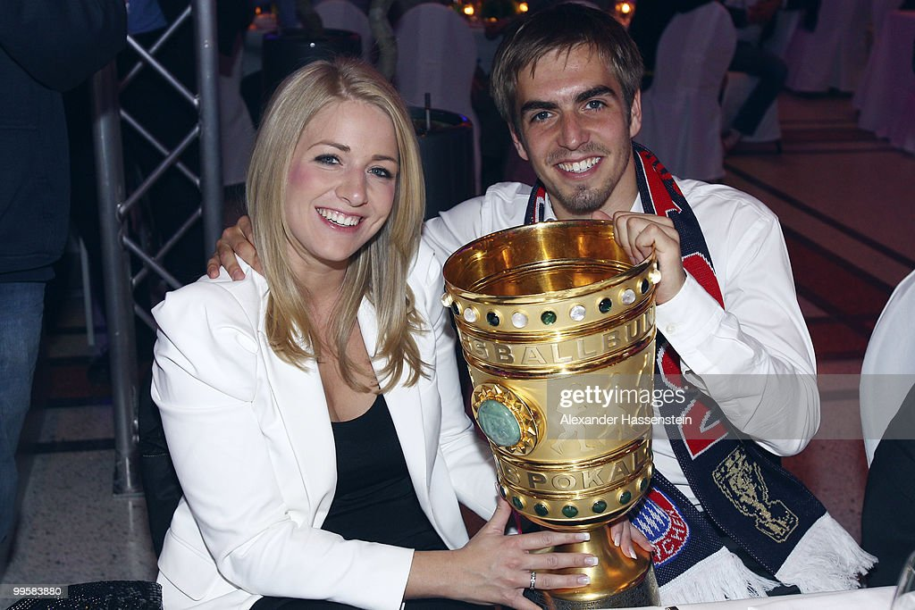 <a gi-track='captionPersonalityLinkClicked' href=/galleries/search?phrase=Philipp+Lahm&family=editorial&specificpeople=483746 ng-click='$event.stopPropagation()'>Philipp Lahm</a> and his girlfriend Claudia Schattenberg attend the Bayern Muenchen Champions Party after the DFB Cup Final match against Werder Bremen at the Deutsche Telekom Represantive House Berlin on May 15, 2010 in Berlin, Germany.