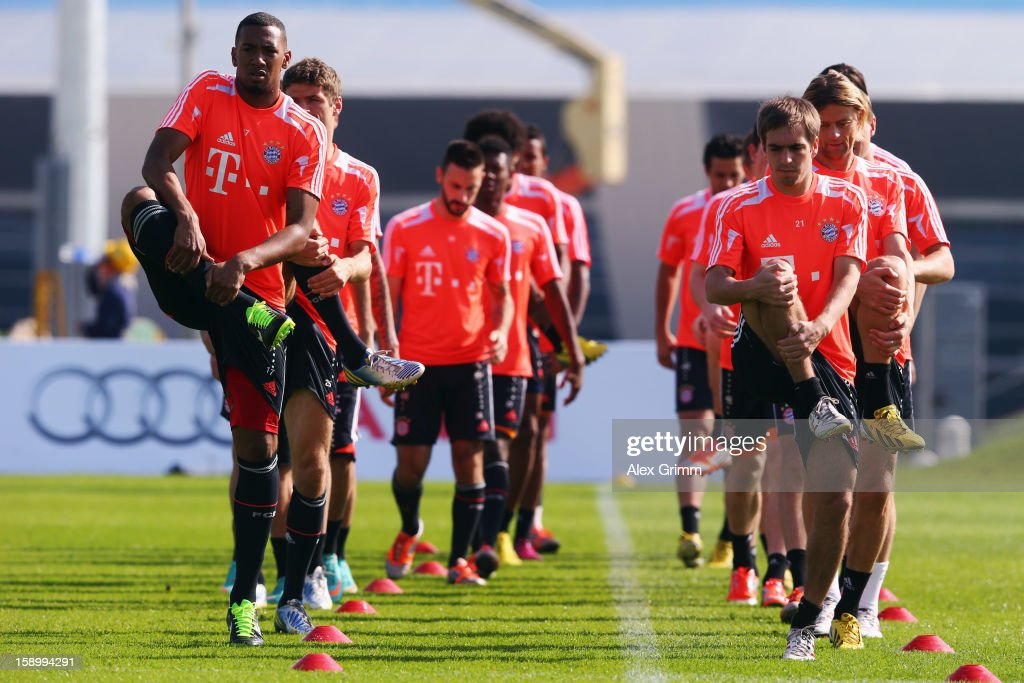 <a gi-track='captionPersonalityLinkClicked' href=/galleries/search?phrase=Philipp+Lahm&family=editorial&specificpeople=483746 ng-click='$event.stopPropagation()'>Philipp Lahm</a> and <a gi-track='captionPersonalityLinkClicked' href=/galleries/search?phrase=Jerome+Boateng&family=editorial&specificpeople=2192287 ng-click='$event.stopPropagation()'>Jerome Boateng</a> (front) exercise with team mates during a Bayern Muenchen training session at the ASPIRE Academy for Sports Excellence on January 5, 2013 in Doha, Qatar.
