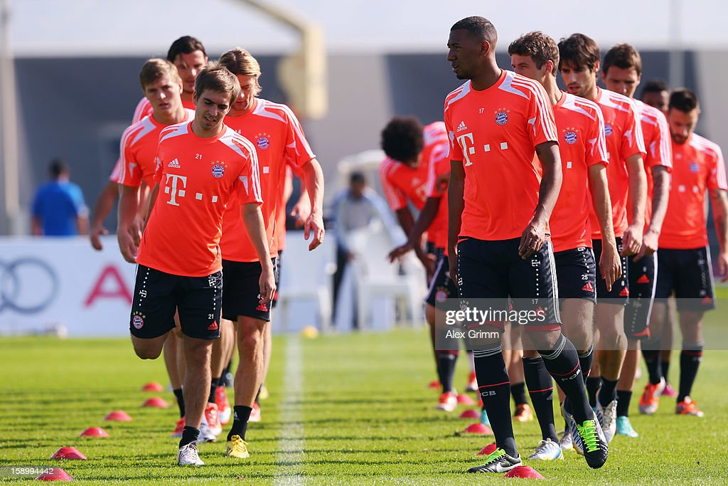 <a gi-track='captionPersonalityLinkClicked' href=/galleries/search?phrase=Philipp+Lahm&family=editorial&specificpeople=483746 ng-click='$event.stopPropagation()'>Philipp Lahm</a> (L) and <a gi-track='captionPersonalityLinkClicked' href=/galleries/search?phrase=Jerome+Boateng&family=editorial&specificpeople=2192287 ng-click='$event.stopPropagation()'>Jerome Boateng</a> exercise with team mates during a Bayern Muenchen training session at the ASPIRE Academy for Sports Excellence on January 5, 2013 in Doha, Qatar.