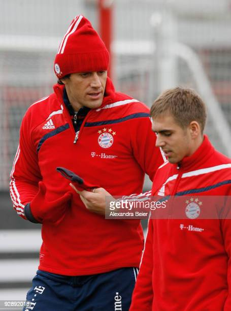 Philipp Lahm and Luca Toni chat during the Bayern Muenchen training session at Bayern's training ground 'Saebener Strasse' on November 8 2009 in...