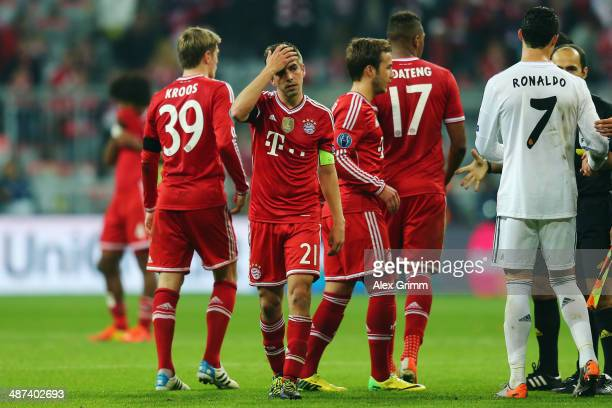 Philipp Lahm and team mates of Muenchen react after the UEFA Champions League semi final match between FC Bayern Muenchen and Real Madrid at Allianz...