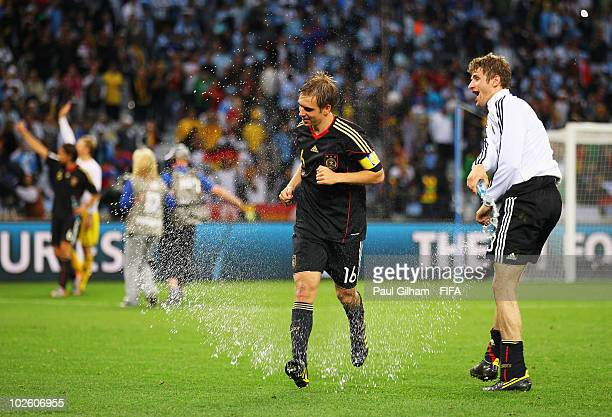 Philipp Lahm and teammate Thomas Mueller of Germany celebrate after the 2010 FIFA World Cup South Africa Quarter Final match between Argentina and...