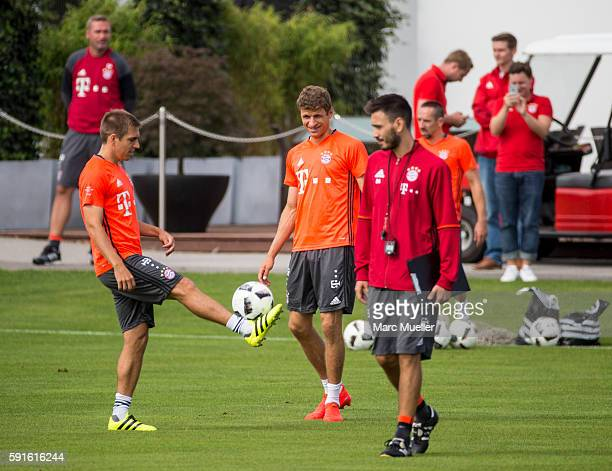 Philipp Lahm and Thomas Müller of FC Bayern Munich is seen during an training session on August 17 2016 in Munich Germany