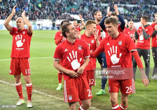 Philipp Lahm and Thomas Mller of Muenchen celebrate winning the Bundesliga title after the Bundesliga match between VfL Wolfsburg and Bayern Muenchen...