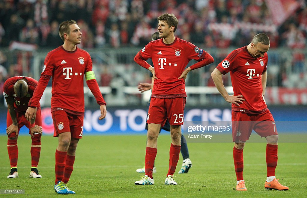 Philipp Lahm (21) and Thomas Mueller (25) and Franck Ribery of Bayern Munich (7) look dejected after the UEFA Champions League semi final second leg match between FC Bayern Muenchen and Club Atletico de Madrid at Allianz Arena on May 3, 2016 in Munich, Germany. Bayern Munich won the match 2-1, but Atletico Madrid reached the final on the away goals rule.
