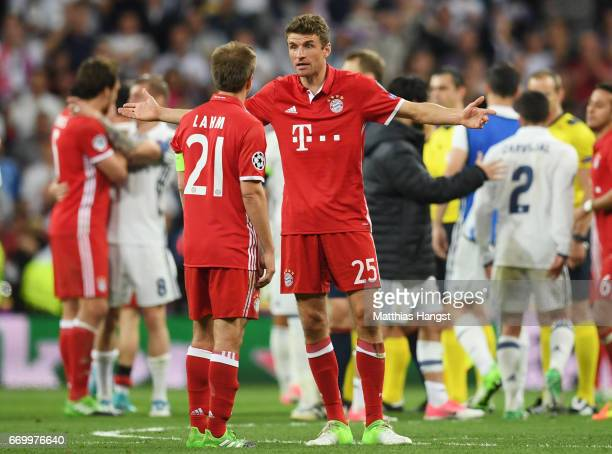 Philipp Lahm and Thomas Mueller of Bayern Muenchen in discussion after defeat in the UEFA Champions League Quarter Final second leg match between...
