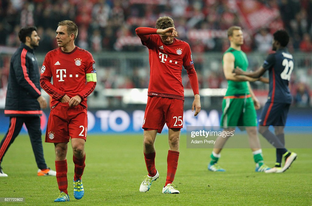 Philipp Lahm (21) and Thomas Mueller of Bayern Munich (25) look dejected after the UEFA Champions League semi final second leg match between FC Bayern Muenchen and Club Atletico de Madrid at Allianz Arena on May 3, 2016 in Munich, Germany. Bayern Munich won the match 2-1, but Atletico Madrid reached the final on the away goals rule.