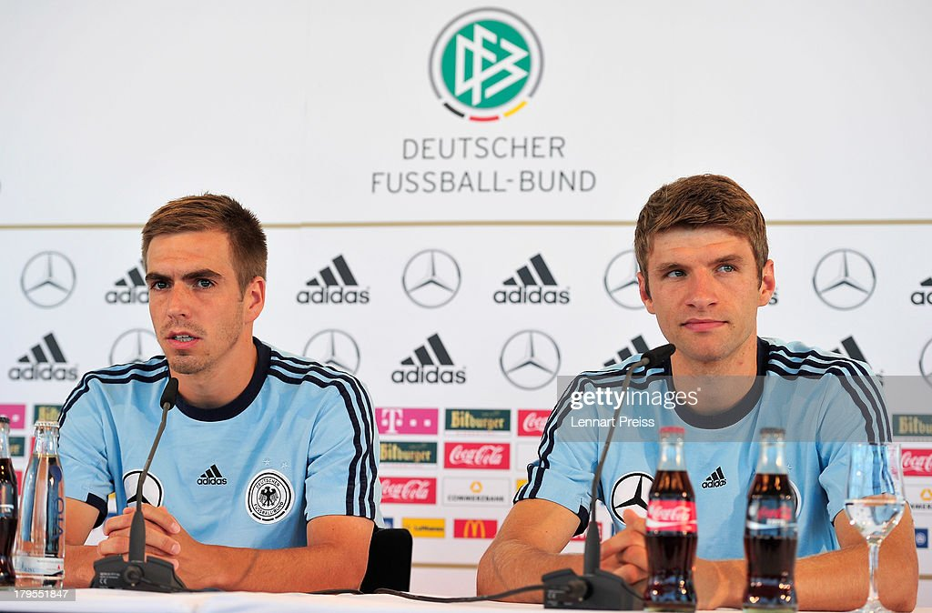 Philipp Lahm (L) and Thomas Mueller of Germany attend a press conference ahead of their FIFA World Cup qualifier against Austria, at the Mercedes Benz Center on September 5, 2013 in Munich, Germany.