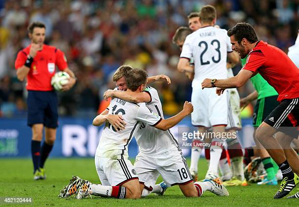 Philipp Lahm and Toni Kroos of Germany celebrate the 10 win after the 2014 FIFA World Cup Brazil Final match between Germany and Argentina at...