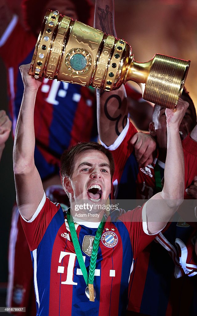 <a gi-track='captionPersonalityLinkClicked' href=/galleries/search?phrase=Philipp+Lahm&family=editorial&specificpeople=483746 ng-click='$event.stopPropagation()'>Philipp Lahm</a> Captain of Bayern Muenchen with lifts the trophy to celebrate after winning the DFB Cup Final match in between Borussia Dortmund and FC Bayern Muenchen at Olympiastadion on May 17, 2014 in Berlin, Germany.
