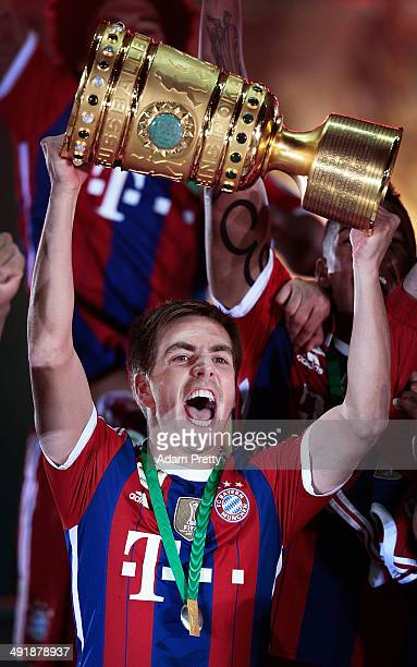 Philipp Lahm Captain of Bayern Muenchen with lifts the trophy to celebrate after winning the DFB Cup Final match in between Borussia Dortmund and FC...