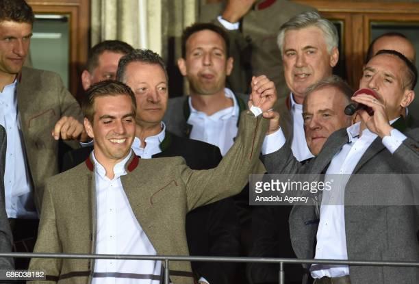 Philipp Lahm coach Carlo Ancelotti and Franck Ribery of Bayern Munich celebrate winning the German soccer championship on a balcony of the town hall...