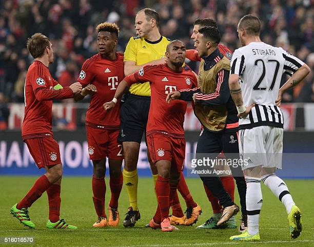 Philipp Lahm David Alaba Douglas Costa and Thiago of Bayern Munich celebrate scoring a goal during the UEFA Champions League round of 16 second leg...