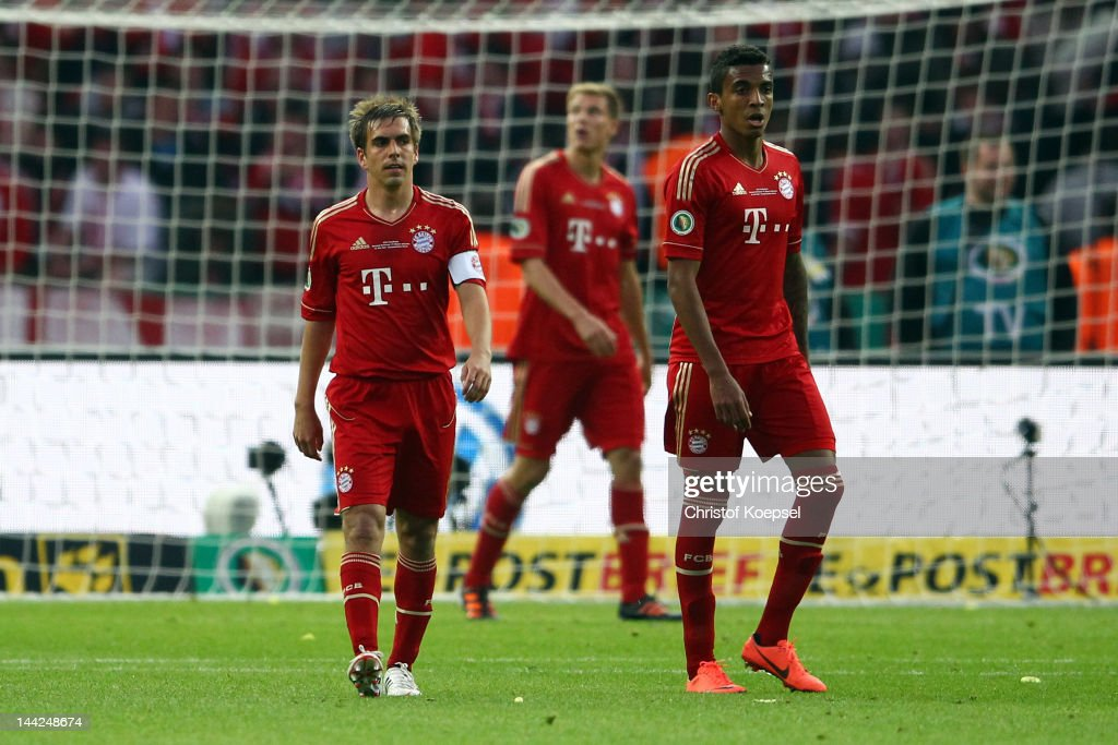 <a gi-track='captionPersonalityLinkClicked' href=/galleries/search?phrase=Philipp+Lahm&family=editorial&specificpeople=483746 ng-click='$event.stopPropagation()'>Philipp Lahm</a>, <a gi-track='captionPersonalityLinkClicked' href=/galleries/search?phrase=Holger+Badstuber&family=editorial&specificpeople=4331362 ng-click='$event.stopPropagation()'>Holger Badstuber</a> and Luiz Gustavo of Bayern look dejected after the third goal of Dortmund during the DFB Cup final match between Borussia Dortmund and FC Bayern Muenchen at Olympic Stadium on May 12, 2012 in Berlin, Germany.