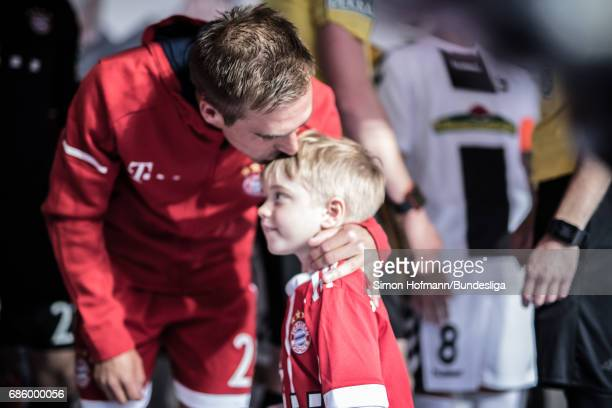 Philipp Lahm hugs his son in the player's tunnel prior to the Bundesliga match between Bayern Muenchen and SC Freiburg at Allianz Arena on May 20...