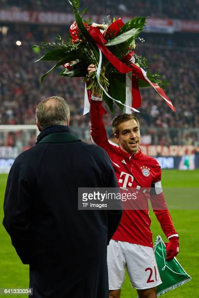 Philipp Lahm is honoured for 500 Bundesliga appearances prior during the DFB Cup RoandOf 16 match between Bayern Muenchen and VfL Wolfsburg at...