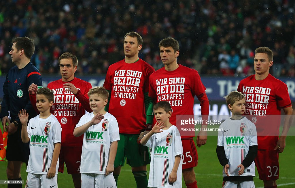<a gi-track='captionPersonalityLinkClicked' href=/galleries/search?phrase=Philipp+Lahm&family=editorial&specificpeople=483746 ng-click='$event.stopPropagation()'>Philipp Lahm</a>, <a gi-track='captionPersonalityLinkClicked' href=/galleries/search?phrase=Manuel+Neuer&family=editorial&specificpeople=764621 ng-click='$event.stopPropagation()'>Manuel Neuer</a>, <a gi-track='captionPersonalityLinkClicked' href=/galleries/search?phrase=Thomas+Mueller&family=editorial&specificpeople=5842906 ng-click='$event.stopPropagation()'>Thomas Mueller</a> and <a gi-track='captionPersonalityLinkClicked' href=/galleries/search?phrase=Joshua+Kimmich&family=editorial&specificpeople=9479434 ng-click='$event.stopPropagation()'>Joshua Kimmich</a> of Bayern Munich wear t-shirts showing support for injured team mate Holger Badstuber as they line up prior the Bundesliga match between FC Augsburg and FC Bayern Muenchen at SGL Arena on February 14, 2016 in Augsburg, Germany.