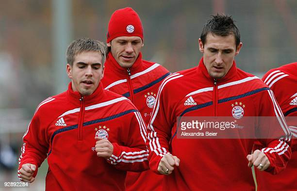 Philipp Lahm Martin Demichelis and Miroslav Klose warm up during the Bayern Muenchen training session at Bayern's training ground 'Saebener Strasse'...