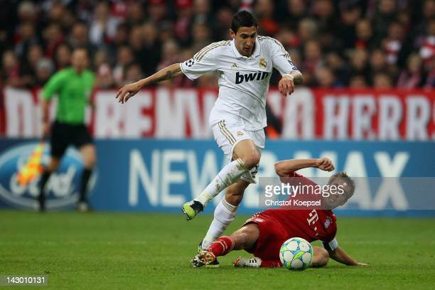Philipp Lahm of Bayern challenges Angfel Di Maria of Real Madrid during the UEFA Champions League Semi Final first leg match between FC Bayern...