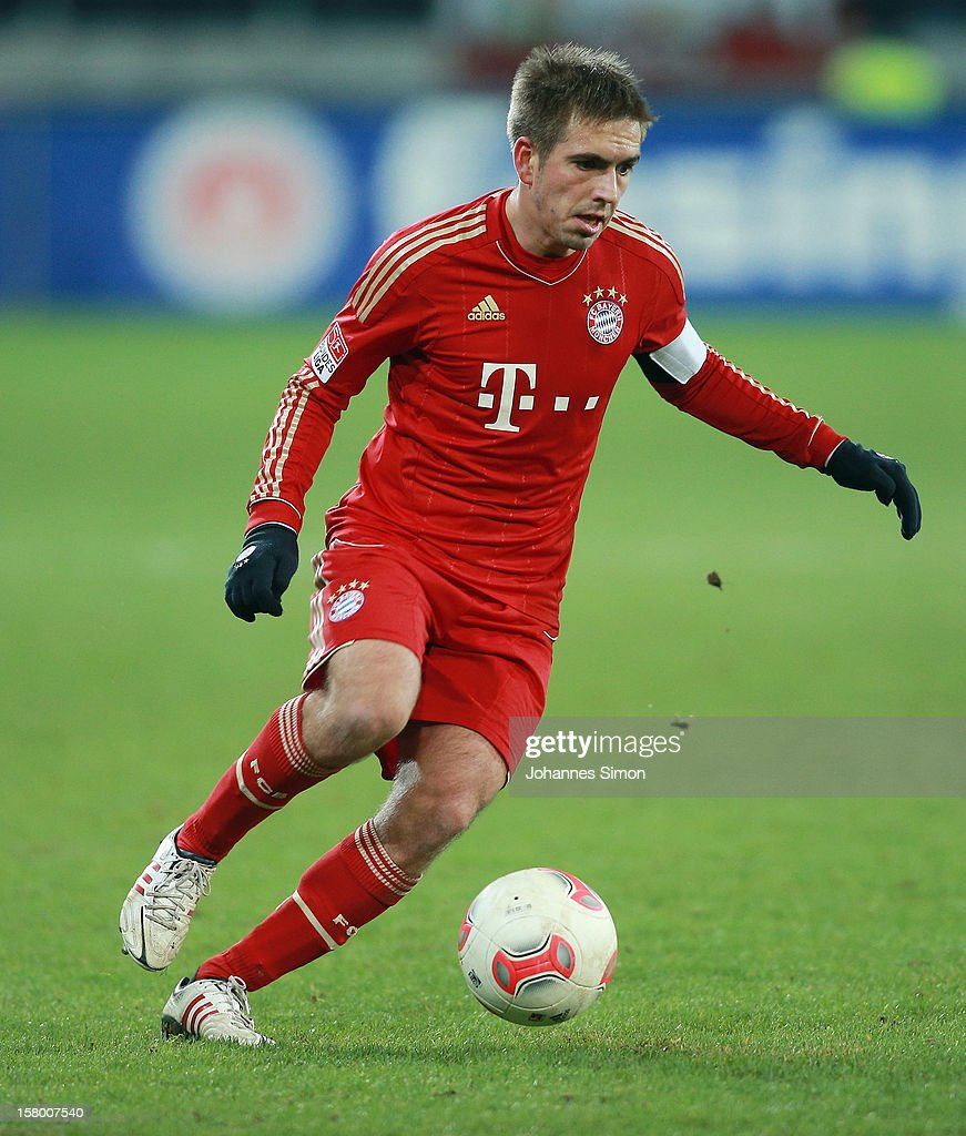 <a gi-track='captionPersonalityLinkClicked' href=/galleries/search?phrase=Philipp+Lahm&family=editorial&specificpeople=483746 ng-click='$event.stopPropagation()'>Philipp Lahm</a> of Bayern in action during the Bundesliga match between FC Augsburg and FC Bayern Muenchen at SGL Arena on December 8, 2012 in Augsburg, Germany.