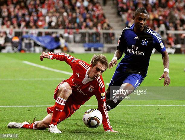 Philipp Lahm of Bayern is defended by Eljero Elia of Hamburg during the Bundesliga match between FC Bayern Muenchen and Hamburger SV at Allianz Arena...
