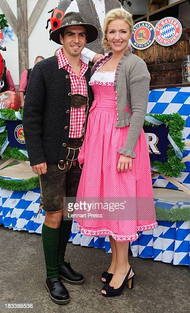 Philipp Lahm of Bayern Muenchen and his wife Claudia attend the Oktoberfest 2013 beer festival at Kaefers Wiesenschaenke on October 6 2013 in Munich...