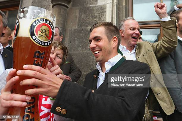 Philipp Lahm of Bayern Muenchen and KarlHeinz Rummenigge CEO of FC Bayern Muenchen celebrates winning the German Championship title on the town hall...