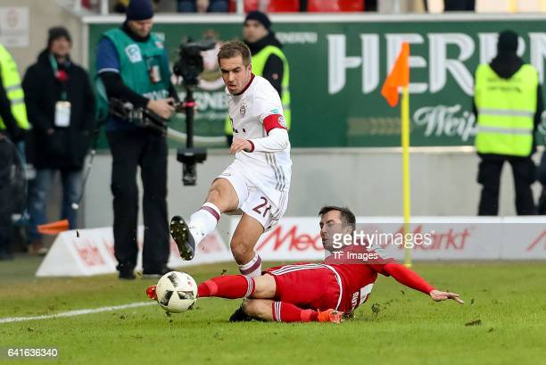 Philipp Lahm of Bayern Muenchen and Markus Suttner of FC Ingolstadt battle for the ball during the Bundesliga match between FC Ingolstadt 04 and...