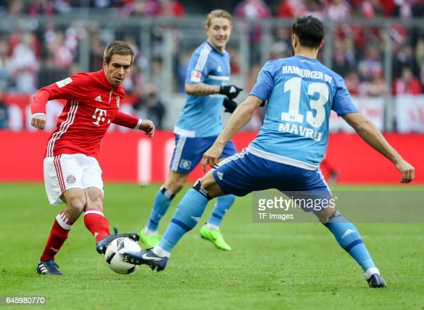 Philipp Lahm of Bayern Muenchen and Mergim Mavraj of Hamburg battle for the ball during the Bundesliga match between Bayern Muenchen and Hamburger SV...