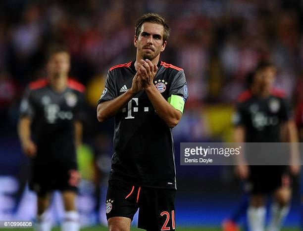 Philipp Lahm of Bayern Muenchen applauds the fans after the UEFA Champions League group D match between Club Atletico de Madrid and FC Bayern...